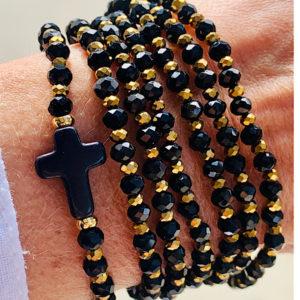 Sautoir Cruz en perles à facettes avec une croix noire