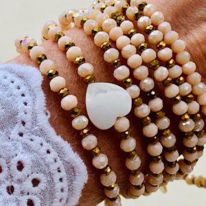 Sautoir Curt en perles à facettes nude