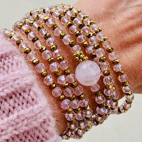 Sautoir Vega en perles à facettes transparentes de couleur rose